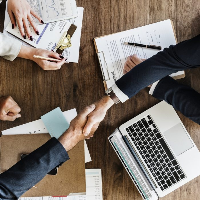 Business people shaking hands together